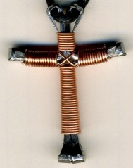 cross with copper wire